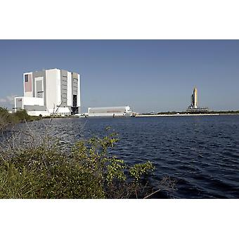 September 4 2008 - Viewed across the turn basin near the Vehicle Assembly Building at the Kennedy Space Center space shuttle Atlantis crawls toward Launch Pad 39A  Poster Print
