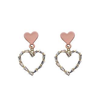 Vergulde oorbellen met roze hart en zirkoon