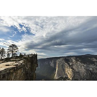 A Yosemite National Park visitor stands at Taft Point which overlooks Yosemite Valley and El Capitan California United States of America PosterPrint