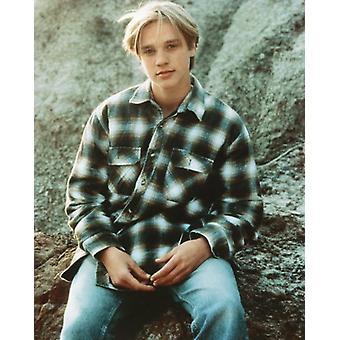 Devon Sawa Photo - Sitting on a rock ledge (8 x 10)