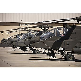 A row of AH-64D Apache Longbow helicopters at Pinal Airpark Arizona Poster Print