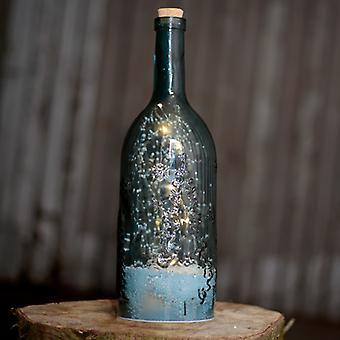 Musical LED Christmas Snowstorm - Blue Embossed Bottle Shaped