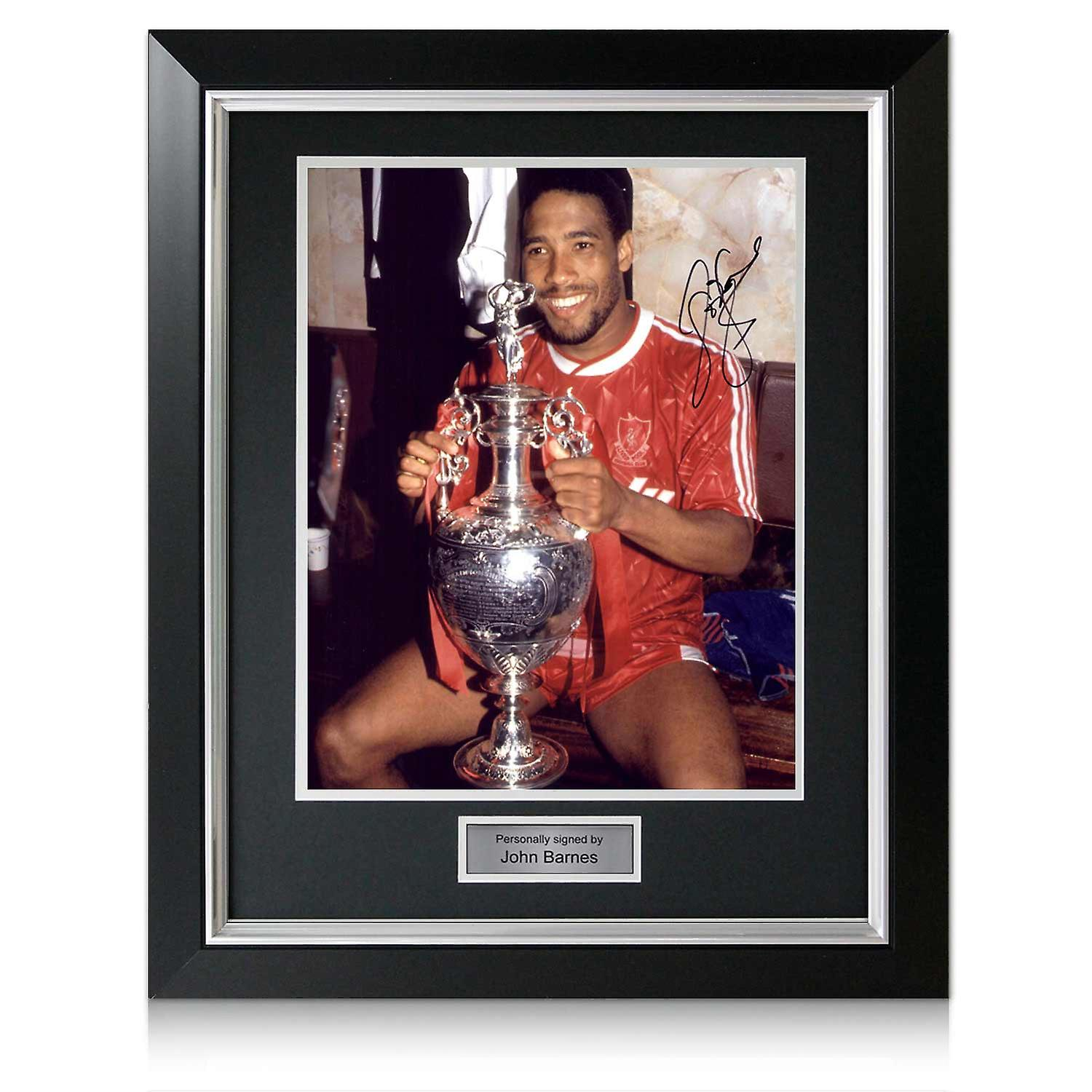 John Barnes Signed Liverpool Photo: Holding The League Trophy. Deluxe Frame