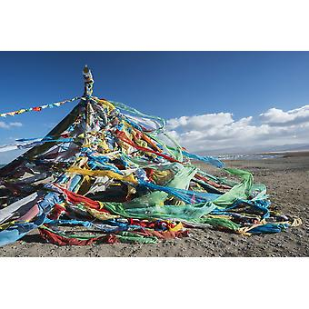 Colourful Tibetan prayer flags (Lung ta) under the strong wind near Qinghai Lake Qinghai province Tibet PosterPrint