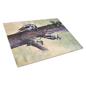 Woodpeckers by Daphne Baxter Glass Cutting Board Large
