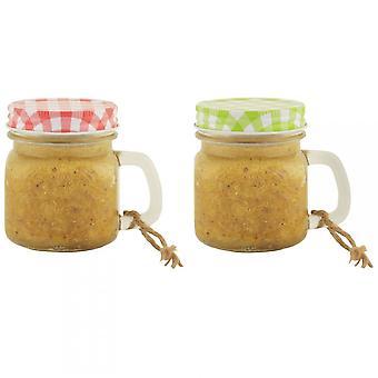 Tazza di vetro di burro di arachidi di frutti caduti assortito