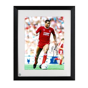 John Barnes Signed Liverpool Photo: On The Wing. Framed
