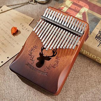 كاليمبا ماهوغاني الإبهام البيانو، إصبع الآلة الموسيقية