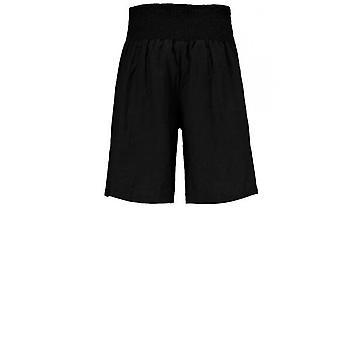 מסאי ביגוד מכנסי פשתן שחורים