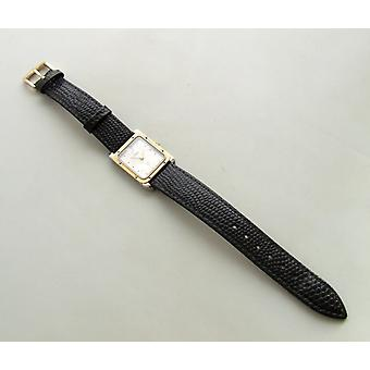 Gold on steel watch with leather strap