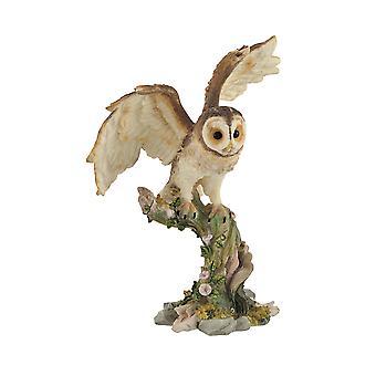 フクロウの止まり木像の翼を広げ