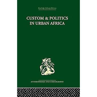 مخصص والسياسة في أفريقيا الحضري دراسة الهوسا المهاجرين في المدن اليوروبا قبل إبنر آند كوهين