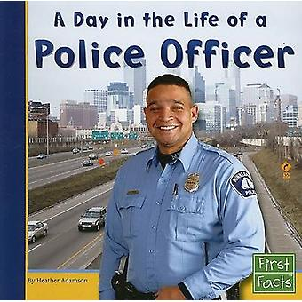 A Day in the Life of a Police Officer by Heather Adamson - 9780736846