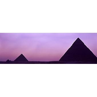Silhouette of pyramids at dusk Giza Egypt Poster Print