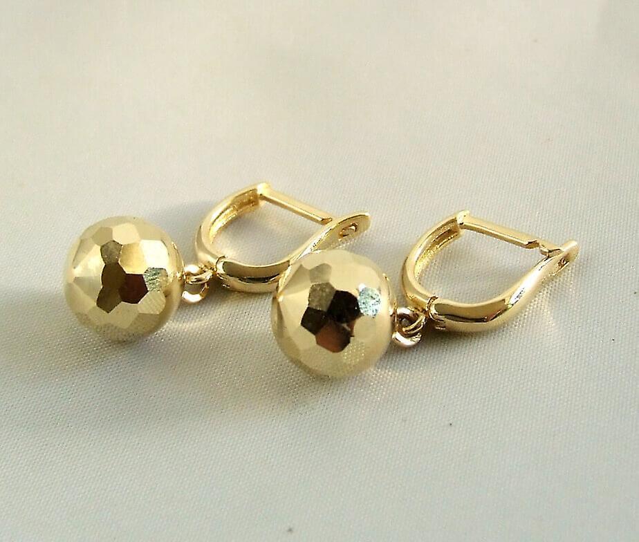 Gouden oorbellen met balletjes