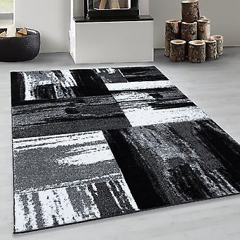Patrón abstracto de diseño de cuadros moderno de la alfombra de diseñador en blanco negro