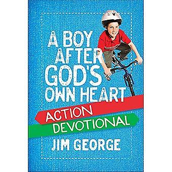 Un ragazzo dopo azione devozionale del cuore di Dio