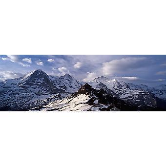 Snow covered mountains Mt Eiger Mt Monch Mt Jungfrau Mt Tschuggen Mt Mannlichen Grindelwald Bernese Oberland Switzerland Poster Print