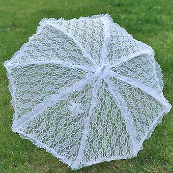 enkle bryllup forsyninger blonder hul brud paraply foto dekorasjon fotografering