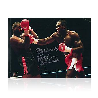 Frank Bruno Signed Boxing Photo: Fighting Oliver McCall