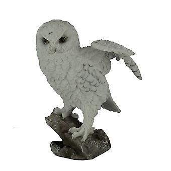 White Snowy Owl Perched On Branch Lifting Wings Statue