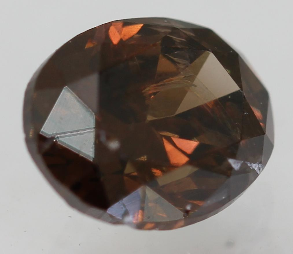Cert 0.69 Carat Vivid Brown VS2 Oval Enhanced Natural Diamond 6.03x4.85mm