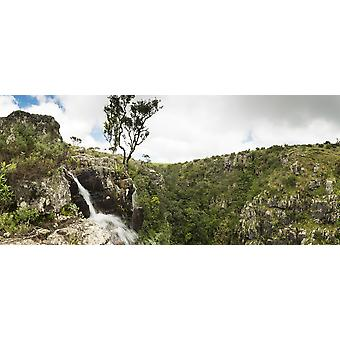 Waterfall flowing over the edge down into the depths of the gorge Wolkberg Conservancy Tzaneen Limpopo Province South Africa Poster Print by Panoramic Images (30 x 14)