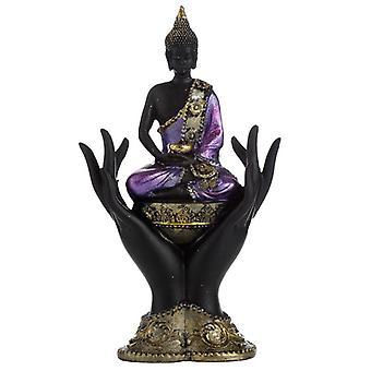 Buda tailandesa roxa, dourada e preta sentada nas mãos