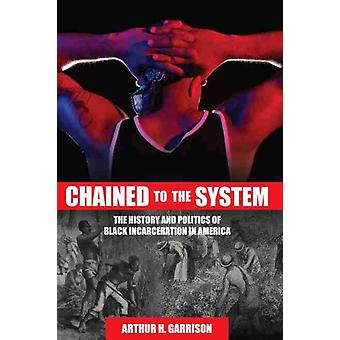 Chained to the System by Garrison & Arthur H.