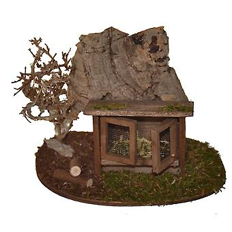 Crib accessories Krippenstall Hasenstall in front of shrubs and rocks made of cork or tree bark - without animals
