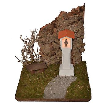 Nativity stable Nativity accessories crib Madonna wayside cross illuminated shrub before wood Bank