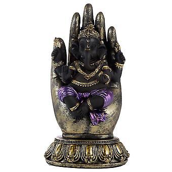 Violetti, kulta ja musta ganesh kädessä