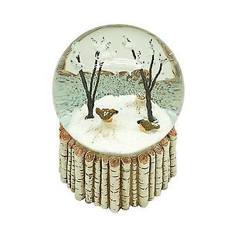 السماء ترسل الطيور في الأشجار ثلج