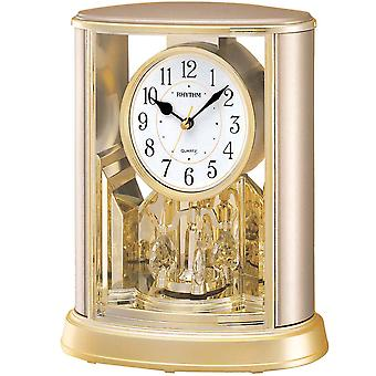 Rhythm 7724/9 table clock quartz analog with rotating pendulum champagne colours