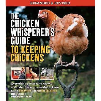 Den kyckling Whisperers guide till att hålla kycklingar reviderade allt du behöver veta... och visste inte att du behövde veta om bakgård och urbana kycklingar av Andy Schneider