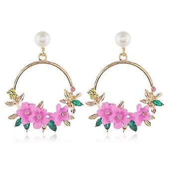 Aros grandes en oro con perla y flores dulces rosas