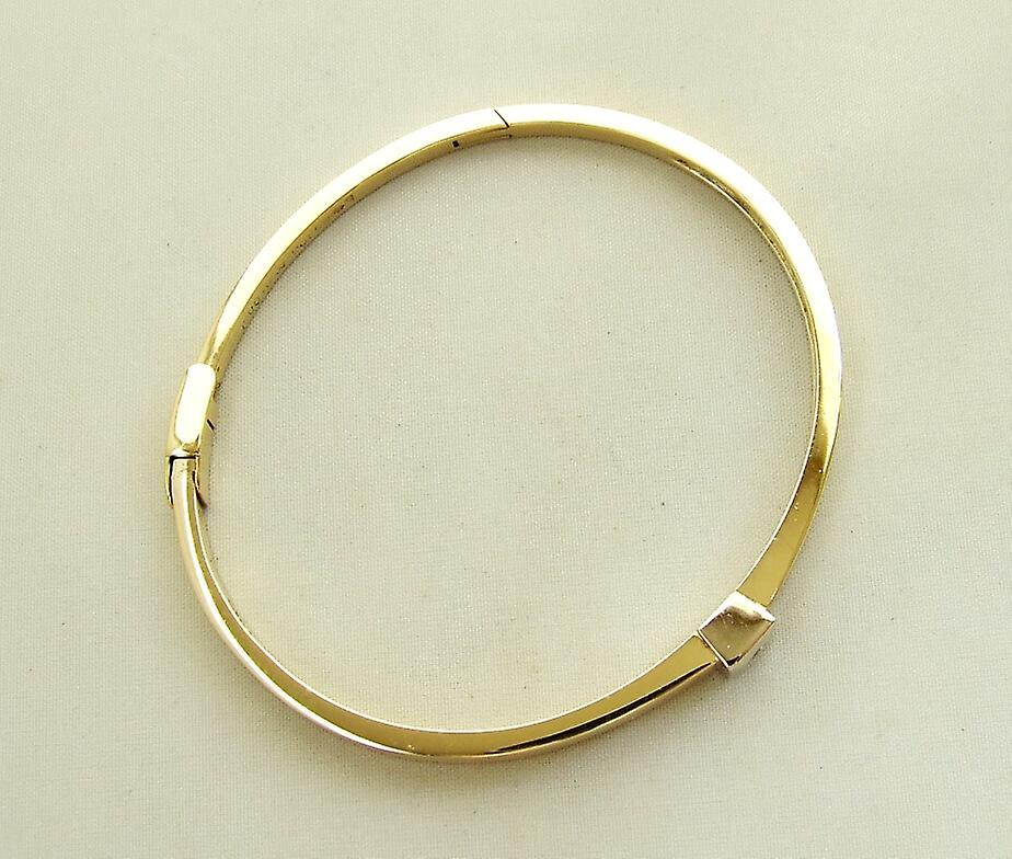 Golden slave bracelet with brilliant