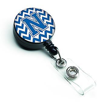 Litera N Chevron niebieski i biały bębnowa chowany odznaka