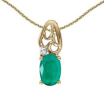 LXR 10k Yellow Gold Oval Emerald and Diamond Pendant 0.31 ct