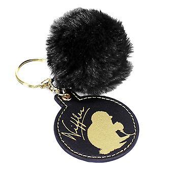 Fantastic Beasts Schlüssel- anhänger Niffler bedruckt, goldfarben/schwarz, Polyurethean, auf Headerkarte.
