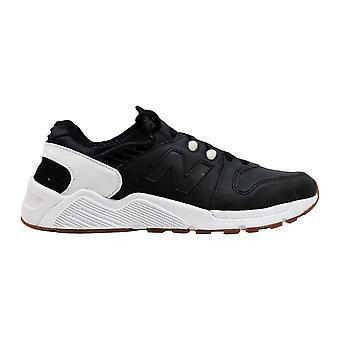 رصيد جديد 009 حذاء رياضي أسود / أبيض ML009UTB الرجال & أبوس؛ق