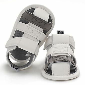 Vastasyntyneet vauvansängyn kengät pehmeä pohja kiinteä koukku syy-seuraus anti slip ensimmäiset kävelijät