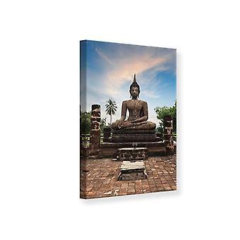 Canvas tulosta Buddha patsas iltahämärässä