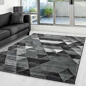 Woonkamer tapijt korte stapel tapijt ontwerper driehoek patroon grijs lichtgrijs gevlekt