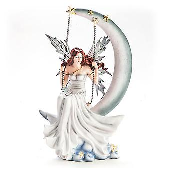 White Fairy Figurine Sitting On A Moon Swing
