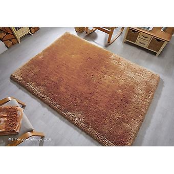 Parelmoer goud tapijt