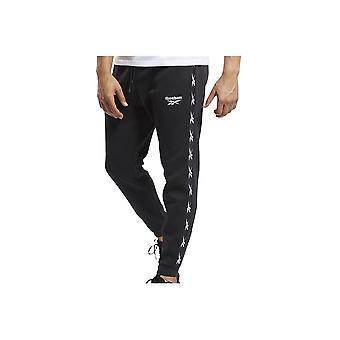 Reebok TE Tape Jogger GQ4215 universal ympäri vuoden miesten housut