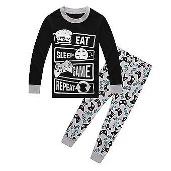 Jungen essen Spiel Schlaf Controller lange Pyjamas