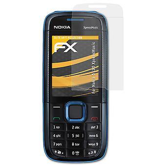 atFoliX Panzerfolie kompatibel mit Nokia 5130 XpressMusic Glasfolie 9H Schutzpanzer