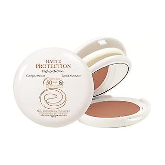 Haute protection compact golden colored SPF50 50 g